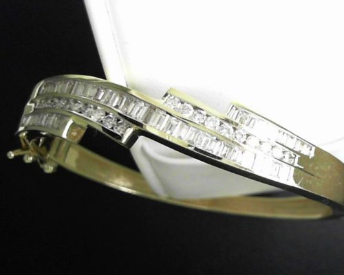 Lady's 14 Karat Yellow Gold Diamond Bangle Bracelet with 5 rows of Channel Set Round and Princess Cut Diamonds